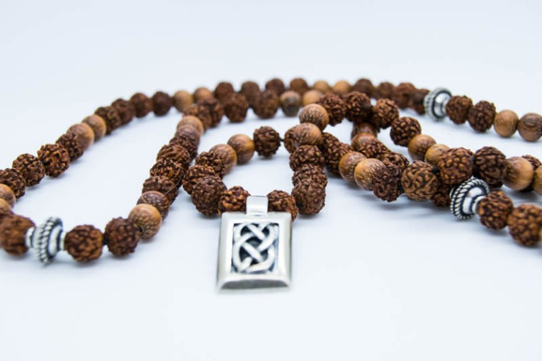 Handknotted 108 mala with bayong wood, rudraksha seeds & silver shannon knot pendant.
