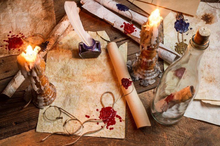 candles-wax-ink-feather-parchment-paper-scrolls-wax-print-sunglasses-a-bottle