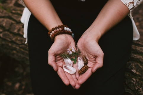 hands with crystals